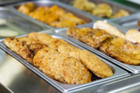 cutlets and meat dishes in buffet on metal plates. selective focus Stock Photo