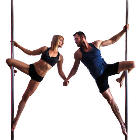 young athletic  woman and bearded man doing strength exercises on a pylon,  isolated on white background, Pole Dance concept.