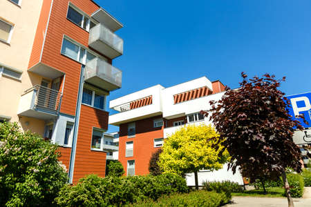 Exterior of a modern  apartment buildings on a blue sky background. No people.  Real estate business concept.