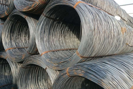 Wire rod is stored in the finished goods warehouse of the metallurgical enterprise.