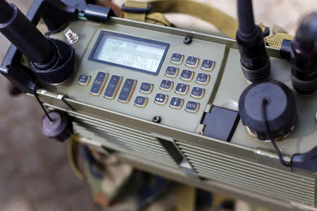 Control panel of a modern military radio station close-up.