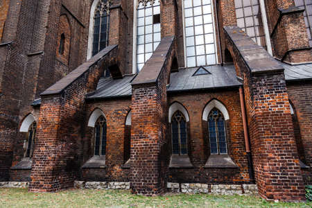 Dark brick wall of an old Catholic cathedral. Low key background.