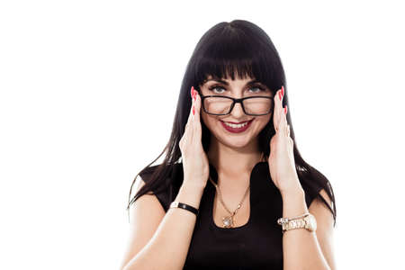 Portrait of young beautiful happy brunette woman with eyeglasses looking at camera smiling, isolated on white background.