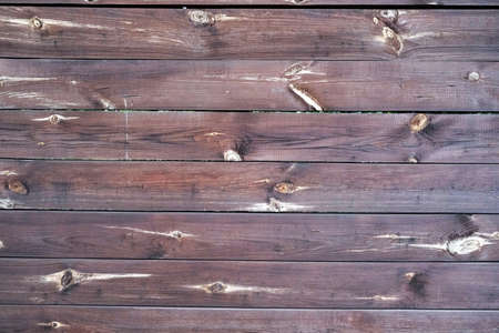 Texture of wooden fence, horizontal logs frame background
