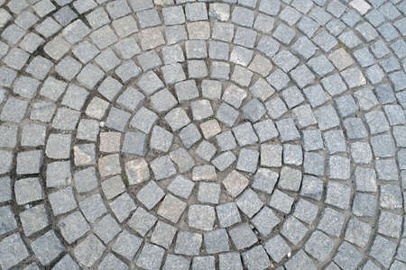 Texture of old Cobbled Pavement close-up. Abstract Granite Stones Circle Round  Background.