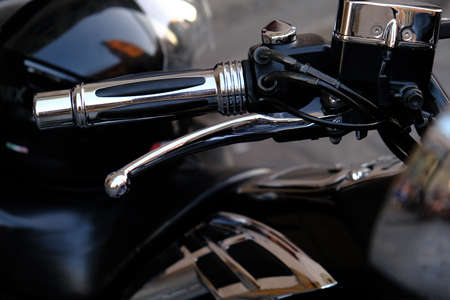 Parts of a Luxury Powerful motorcycle. Handle speed control and brake close-up. Фото со стока