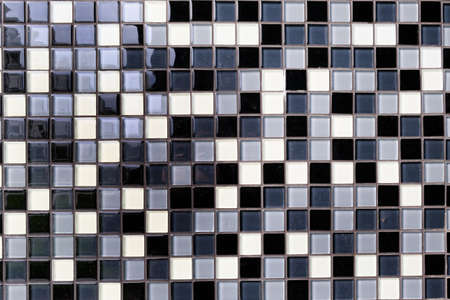 Mosaic Background of Black, White And Gray Ceramic squareTiles.