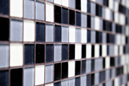 Mosaic Background of Black, White And Gray Ceramic squareTiles. Depth of Field.