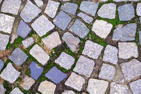 Texture of old Cobbled Pavement close-up. Abstract Granite Stone Background.