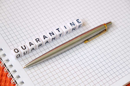 Text Quarantine , word made of cubic letters and luxury pen on a white paper note pad background. Working home at coronavirus pandemia concept Stock Photo
