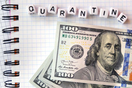 Text Quarantine , word made of cubic letters and american money dollars on a white paper copybook background. Quarantine coronavirus concept Stock Photo