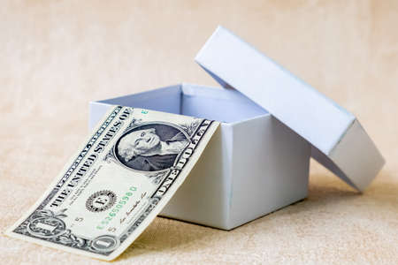 One American Dollar Bank note in white gift box. Studio Shot. Stock Photo