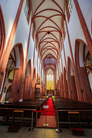 WROCLAW, POLAND - MAY, 2018.  Interior of a medieval catholic cathedral, Wide Angle Shot. Editorial