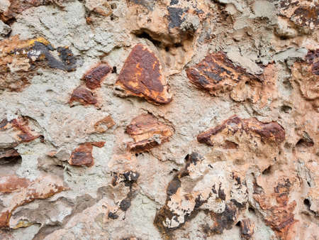 Texture of an old stones wall of abandoned building abstract background.