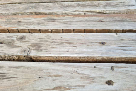 Texture of an old wooden gray bench 写真素材