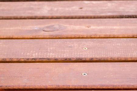 Texture of old wooden brown painted bridge floor abstract background. Depth of field. 写真素材