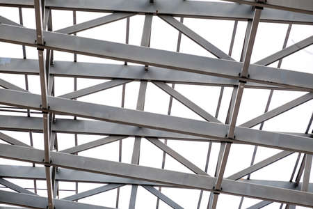 Row of stadium roof metal supports structure. Industrial steel background. No people. 写真素材