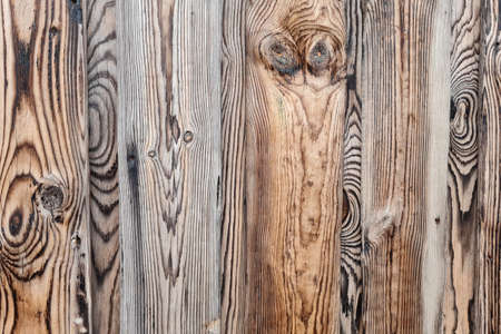 Abstract background of textured gray wooden wall. Exterior of modern building.