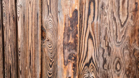 Abstract background of textured dark wooden wall. Exterior of modern building.