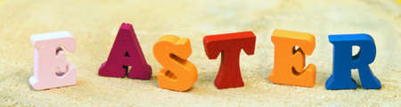 Text Easter of colorful toy alphabet letters on on wooden table. Ideal for design of bright web banner.