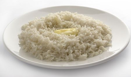 Rice with butter on the plate Stock Photo