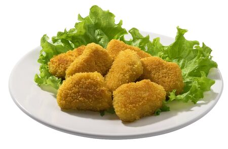 Fried chicken pieces coated with breadcrumbs with lettuce on the white plate Stock Photo - 8558593