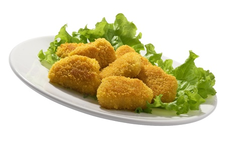 Fried chicken pieces coated with breadcrumbs with lettuce on the white plate