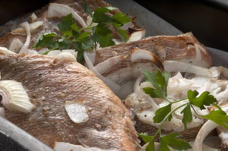 roasting pan: Baked pieces of rosefish in the roasting pan Stock Photo