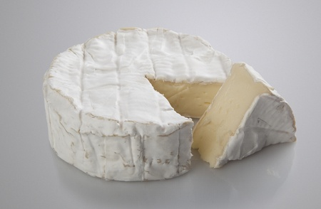 Isolated camembert cheese on the gray background Stock Photo