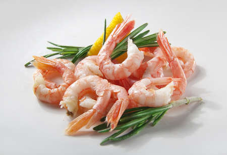 coldwater: Coldwater shrimps with rosemary and lemon on the white Stock Photo