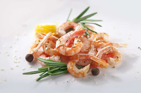 coldwater: Handful of fried shrimps with rosemary and lemon Stock Photo