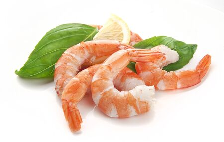 Peeled hot-water shrimps tails with basil and lemon