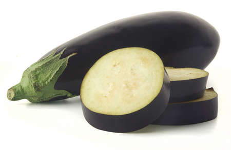Whole and cutted eggplant on the white background Stock Photo - 14079867