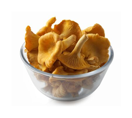 Some yellow chanterelles in the glass bowl