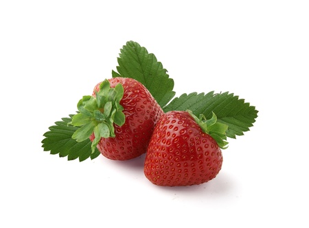 Two fresh strawberries with leaves