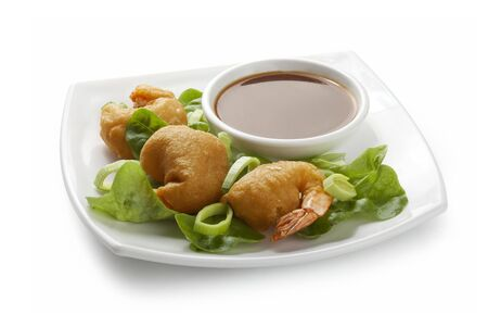 palate: Shrimp tempura with lettuce, leek and soy sauce on the white palate Stock Photo