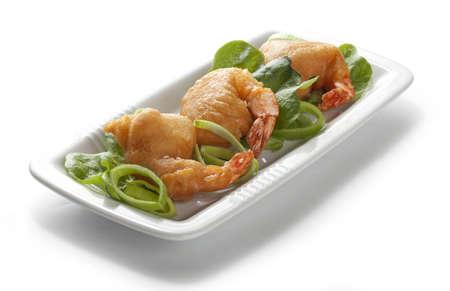 palate: Shrimp tempura with lettuce, leek and sesame on the white palate Stock Photo
