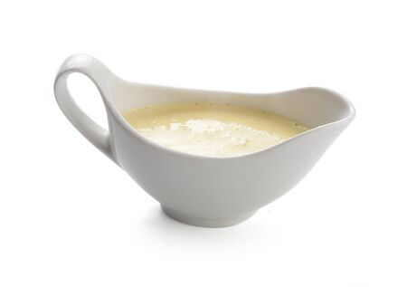 Creamy cheese sauce in the white sauceboat Stock Photo