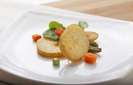 Fried potato with lettuce and vegetables on the white plate Stock Photo - 18090072