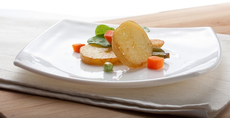 Fried potato with lettuce and vegetables on the white plate Stock Photo - 18231836