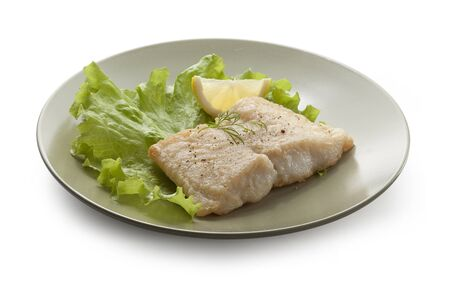 pangasius: Fried fillet of pangasius with lettuce and lemon on the white plate