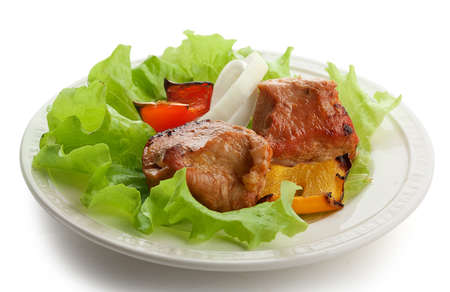 Hot roasted meat with onion, lettuce and pepper on the white plate Stock Photo - 19832507