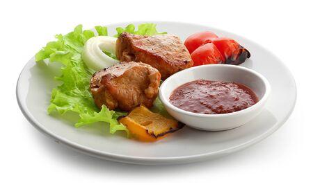 Hot roasted meat with onion, lettuce, pepper and sauce on the white plate Stock Photo - 19832570