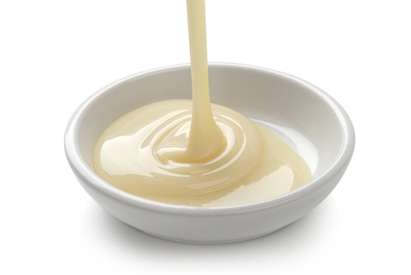 condensed: Condensed milk is flowing in the white plate