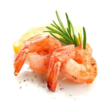 Roasted tails of shrimps with fresh rosemary and lemon