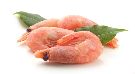 coldwater: Some boiled red small shrimps with green bay leaf on the white Stock Photo