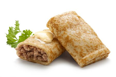 Two rolled meat stuffing pancakes with butter and parsley on the white background Stock Photo - 23290122