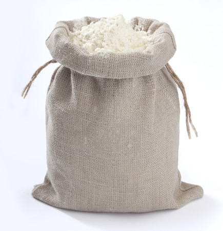 Isolated small sack with white flour on the white background Stock Photo