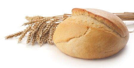 ウクライナの丸い白い背景のムギの束とパン