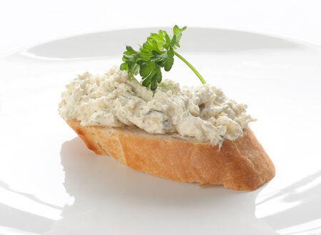 long loaf: Sandwich with long loaf, cottage cheese and parsley on the white plate;